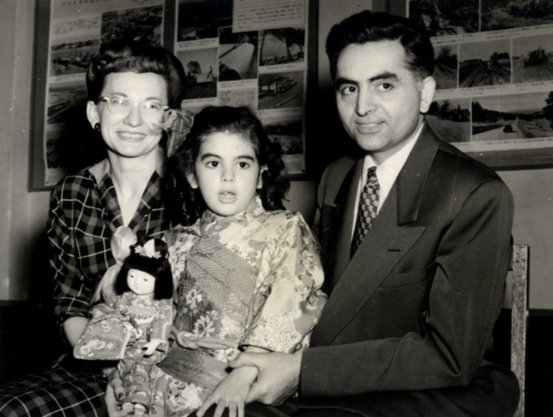Abol Fazl Fotouhi, Agnes Fotouhi, and Farida Fotouhi (Age 6) in front of an American Cultural Center exhibit (circa.1953): photo courtesy Farida Fotouhi.